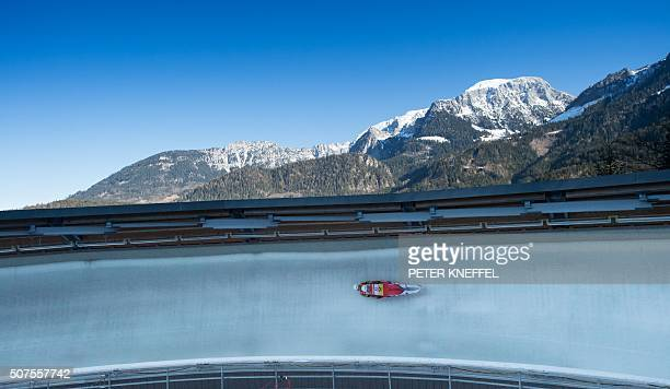 TOPSHOT Austrian team Peter Penz und Georg Fischler race down the ice track during the men's doubles event of the Luge World Championships in...