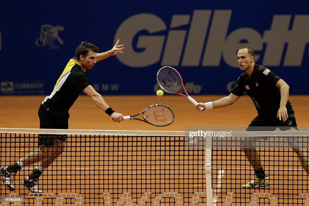 Austrian tennis player Alexander Peya (L) and Brazilian Bruno Soares play during their Brazil Open doubles final match against Czech Frantisek Cermak and Slovakian Michal Mertinak at Ibirapuera gymnasium in Sao Paulo, Brazil, on February 17, 2013. AFP PHOTO/Yasuyoshi CHIBA