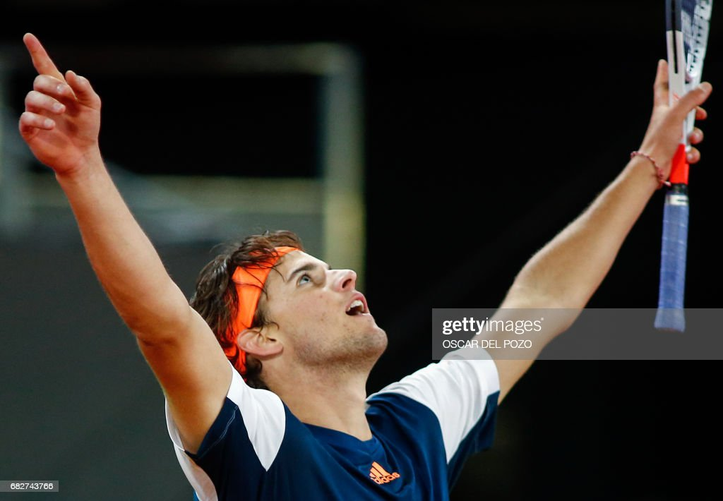 Austrian tennis player Dominic Thiem celebrates his victory over Uruguayan tennis player Pablo Cuevas during the ATP Madrid Open semifinal in Madrid, on May 13, 2017. Thiem won 6-4 and 6-4. /