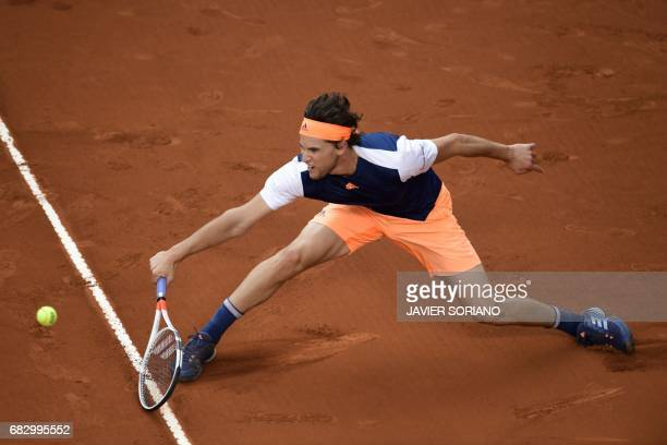 Austrian tennis player Dominic Thiem returns the ball to Spanish tennis player Rafael Nadal during their ATP Madrid Open final match in Madrid on May...