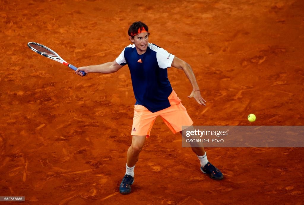 Austrian tennis player Dominic Thiem returns the ball to Uruguayan tennis player Pablo Cuevas during the ATP Madrid Open semifinal in Madrid, on May 13, 2017. /