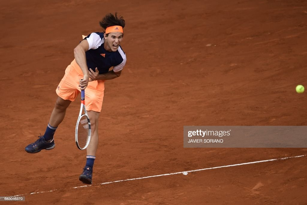 Austrian tennis player Dominic Thiem serves to Spanish tennis player Rafael Nadal during their ATP Madrid Open final match in Madrid, on May 14, 2017. Nadal won 7-6 and 6-4. /