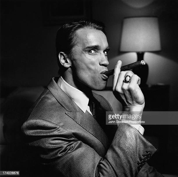 Austrianborn actor Arnold Schwarzenegger smoking a cigar in 1988
