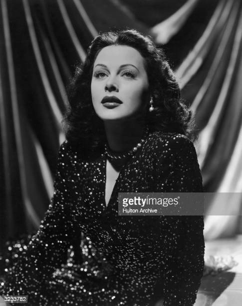 Austrianborn actor Hedy Lamarr wearing a sequined gown looks up in a promotional portrait for director Alexander Hall's film 'The Heavenly Body'