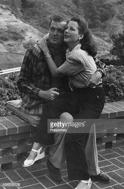 Austrianborn American actress Hedy Lamarr with her third husband English actor John Loder on the terrace at their home In Benedict Canyon Beverly...