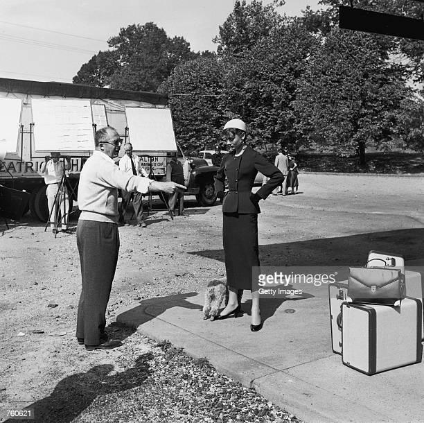 Austrianborn director Billy Wilder points to some luggage next to Belgianborn actress Audrey Hepburn on the set of the film 'Sabrina' in October 1953...