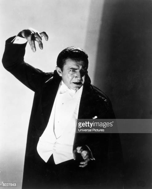 AustrianHungarian born actor Bela Lugosi clenches his hand in the air in a still from director Tod Browning's film 'Dracula'