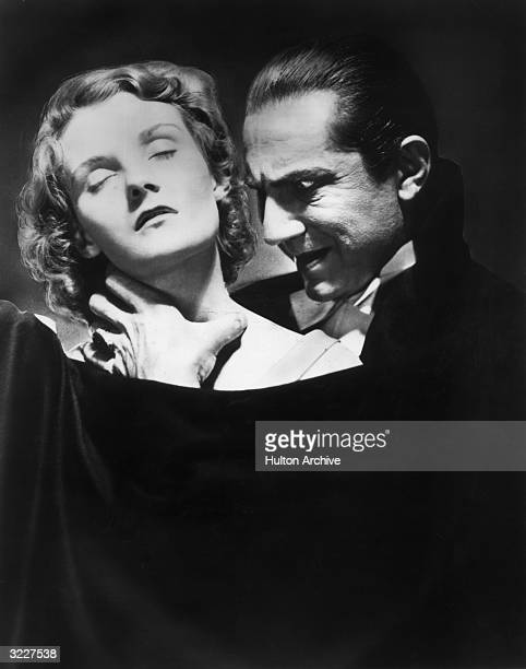 AustrianHungarian born actor Bela Lugosi prepares to bite the neck of an unconscious young woman in a still from director Tod Browning's film...