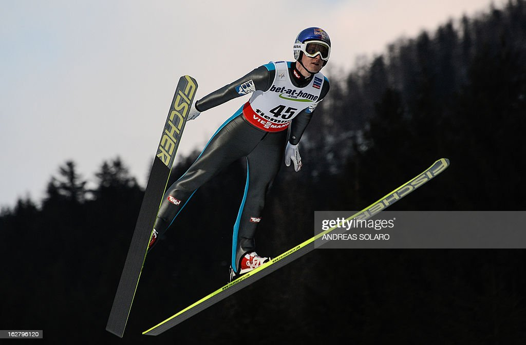 Austrian's Thomas Morgenstern soars through the air on February 27, 2013 during the Large Hill Individual qualification race of the FIS Nordic World Ski Championships at the Ski Jumping stadium in Predazzo, northern Italy. AFP PHOTO / ANDREAS SOLARO