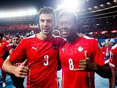 Austria's Aleksandar Dragovic and David Alaba celebrate after winning the Euro 2016 qualifying Group G football match between Austria and Moldova in...