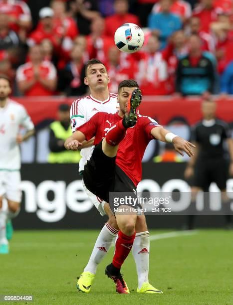Austria's Aleksandar Dragovic and Hungary's Adam Szalai battle for the ball