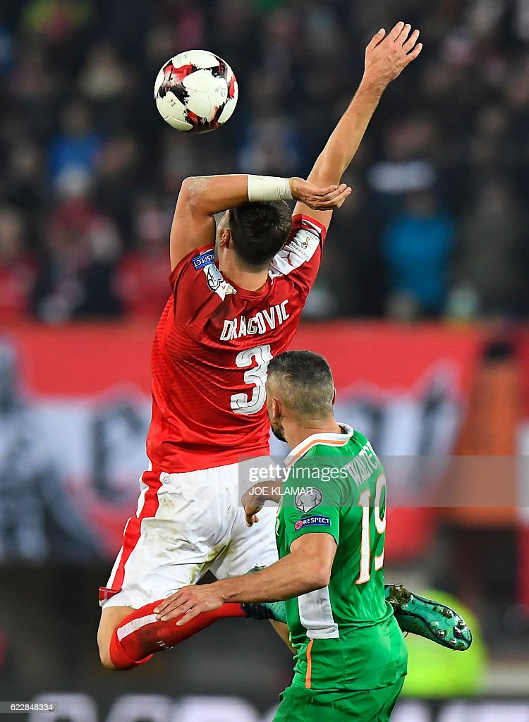 Austria's Aleksandar Dragovic (L) vies with Ireland's Jon Walters during the World Cup 2018 qualification football match between Austria and Ireland in Vienna on November 12, 2016. / AFP / JOE