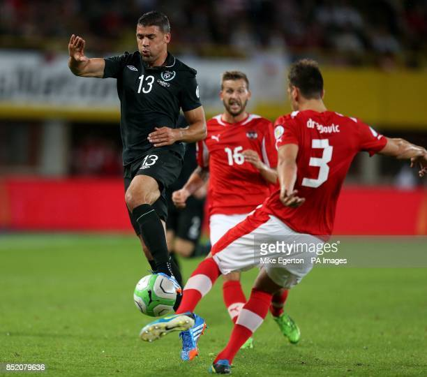 Austria's Aleksander Dragovic and Republic of Ireland's Jonathan Walters during the FIFA World Cup Qualifying match at the Ernst Happel Stadium...