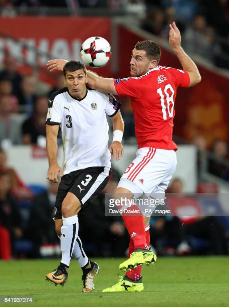 Austria's Aleksander Dragovic and Wales' Sam Vokes in action during the 2018 FIFA World Cup Qualifying Group D match at the Cardiff City Stadium