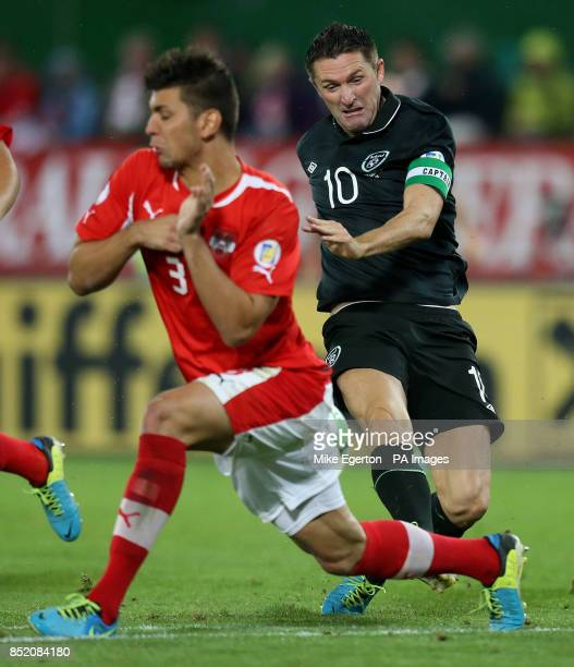 Austria's Aleksander Dragovic blocks a shot from Republic of Ireland's Robbie Keane during the FIFA World Cup Qualifying match at the Ernst Happel...