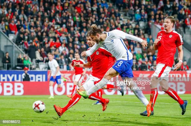 Austria's Alexandar Dragovic and Finland's Perparim Hetemaj vie for the ball during the friendly football match between Austria and Finland in...
