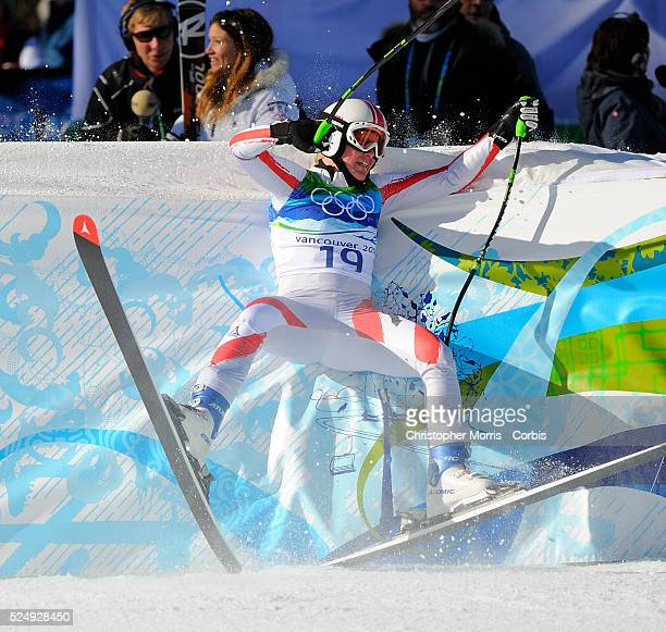 Austria's Andrea Fischbacher crashes into the safety barricade after her gold medal winning run in the ladies super G alpine race at Whistler on day...