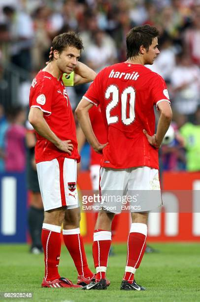 Austria's Andreas Ivanschitz and Martin Harnik dejected after the final whistle