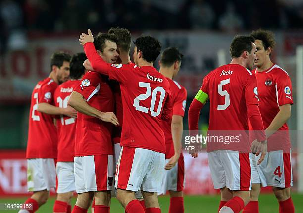 Austria's Andreas Ivanschitz celebrates with Philipp Hosiner and teammates after scoring a goal against Faroe Islands' national football team during...