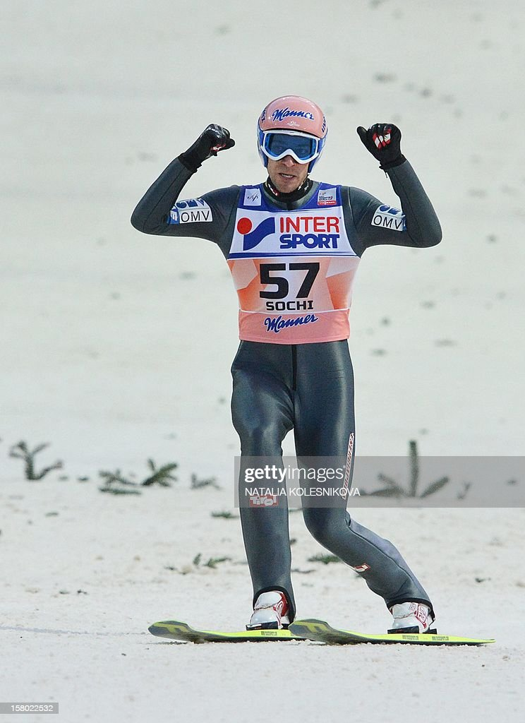 Austria's Andreas Kofler celebrates after his jump during the men's normal hill individual at the FIS Ski Jumping World Cup tournament in Sochi on December 9, 2012. Kofler won the competition.