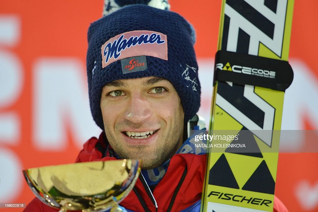 Austria's Andreas Kofler celebrates after the men's normal hill individual at the FIS Ski Jumping World Cup tournament in Sochi on December 9, 2012. Kofler won the competition.