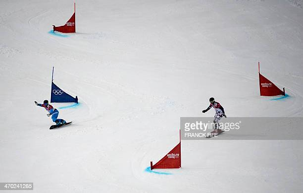 Austria's Andreas Prommegger and Russia's Andrey Sobolev compete in the Men's Snowboard Parallel Giant Slalom 1/8 Finals at the Rosa Khutor Extreme...