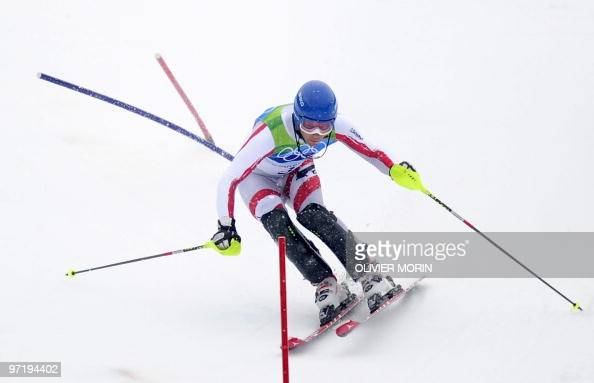 Austria's Benjamin Raich clears a gate during the men's slalom race of the Vancouver 2010 Winter Olympics at the Whistler Creek side Alpine skiing...