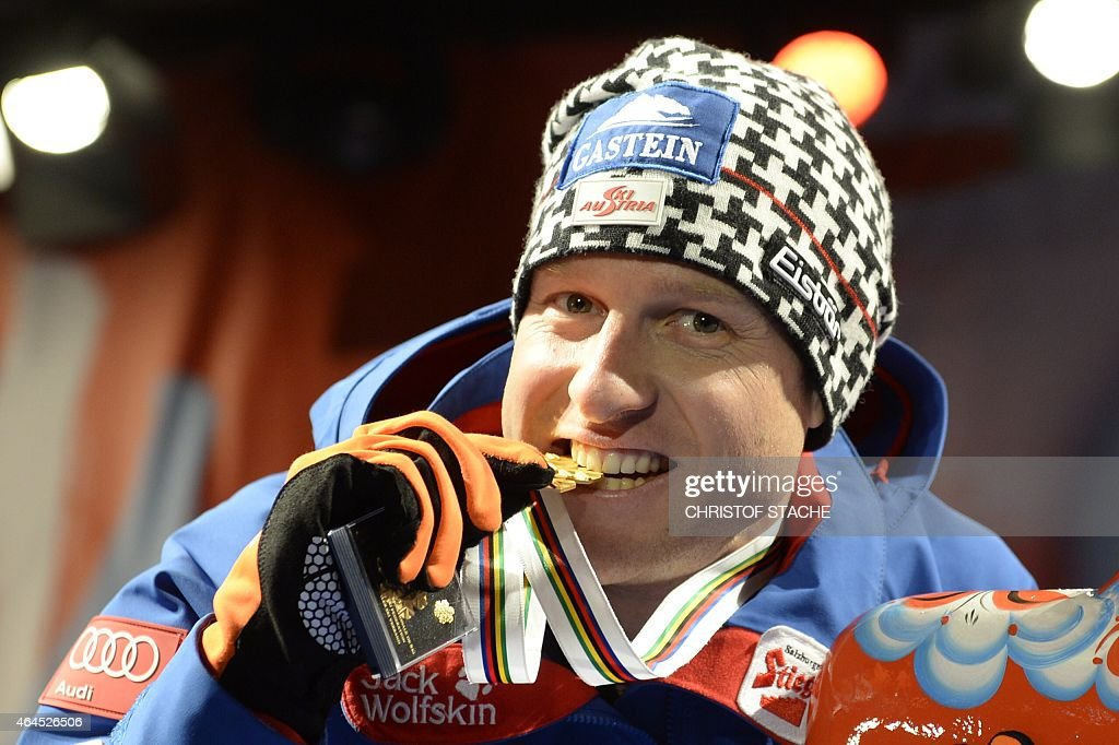 Austria's Bernhard Gruber (1st) celebrates during the medals ceremony of the10km Individual Gundersen Nordic Combined competition in the ski stadium of the 2015 FIS Nordic World Ski Championships in Falun, Sweden, on February 26, 2015.