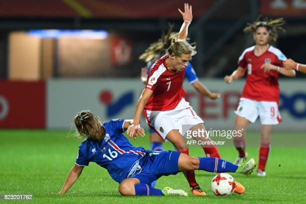 Austria's Carina Wenninger challenges Iceland's Harpa Thorsteinsdottir during the UEFA Women's Euro 2017 football match between Iceland and Austria...