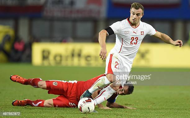 Austria's Christian Fuchs vies with Switzerland's Xherdan Shaqiri during a friendly football match between Austria and Switzerland at Ernst Happel...