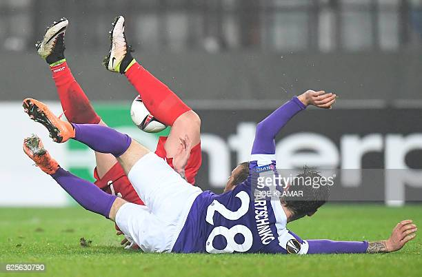 FK Austria's Christoph Martschinko vies for the ball with FC Astra's Denis Alibec during the UEFA Europa League group E football match between...