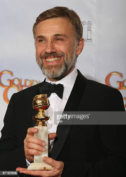 Austria's Christoph Waltz celebrates winning the 67th Golden Globes best supporting actor award for his role in Quentin Tarantino's 'Inglourious...
