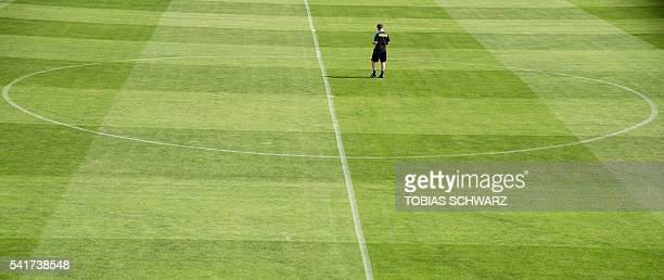 Austria's coach Marcel Koller walks across the pitch as he attends a training session in Mallemort southern France on June 20 during the Euro 2016...