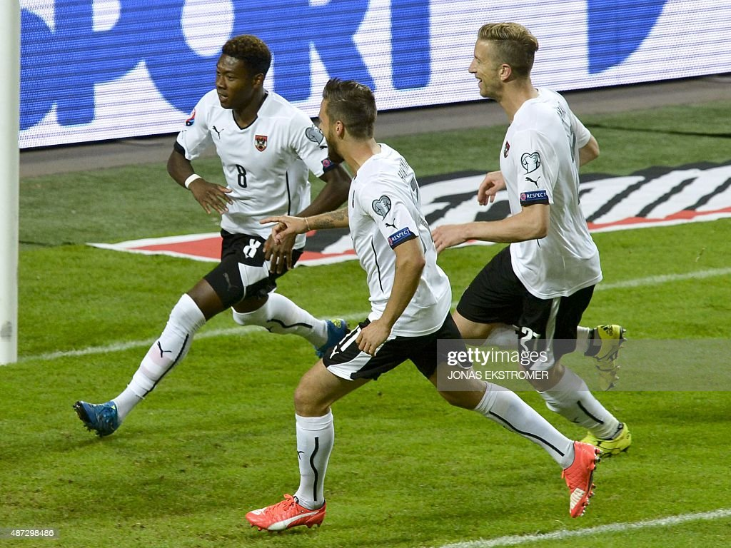 Austria's David Alaba celebrates scoring a penalty with his teammates Martin Harnik and Marc Janko during the Euro 2016 qualifying group G football...