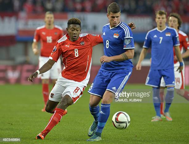Austria's David Alaba fights for a ball with Liechtenstein's Sandro Wieser during the Euro 2016 Group G qualifying football match between Austria and...