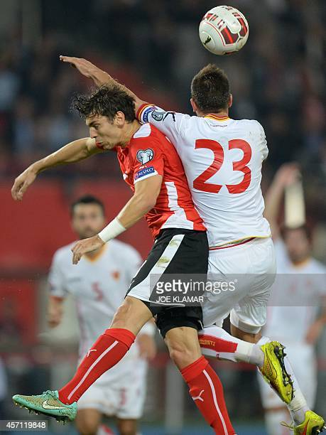 Austria's defender Aleksandar Dragovic and Montenegro's defender Marko Simic vie for the ball during the Euro 2016 Group G qualifying football match...
