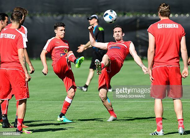 Austria's defender Christian Fuchs and Austria's midfielder Zlatko Junuzovic take part in a training session in Mallemort southern France on June 9...
