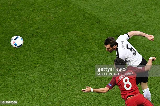 TOPSHOT Austria's defender Christian Fuchs and Portugal's midfielder Joao Moutinho vie for the ball during the Euro 2016 group F football match...