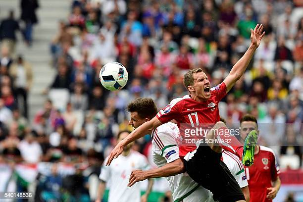 TOPSHOT Austria's defender Florian Klein vies with Hungary's midfielder Adam Nagy during the Euro 2016 group F football match between Hungary and...
