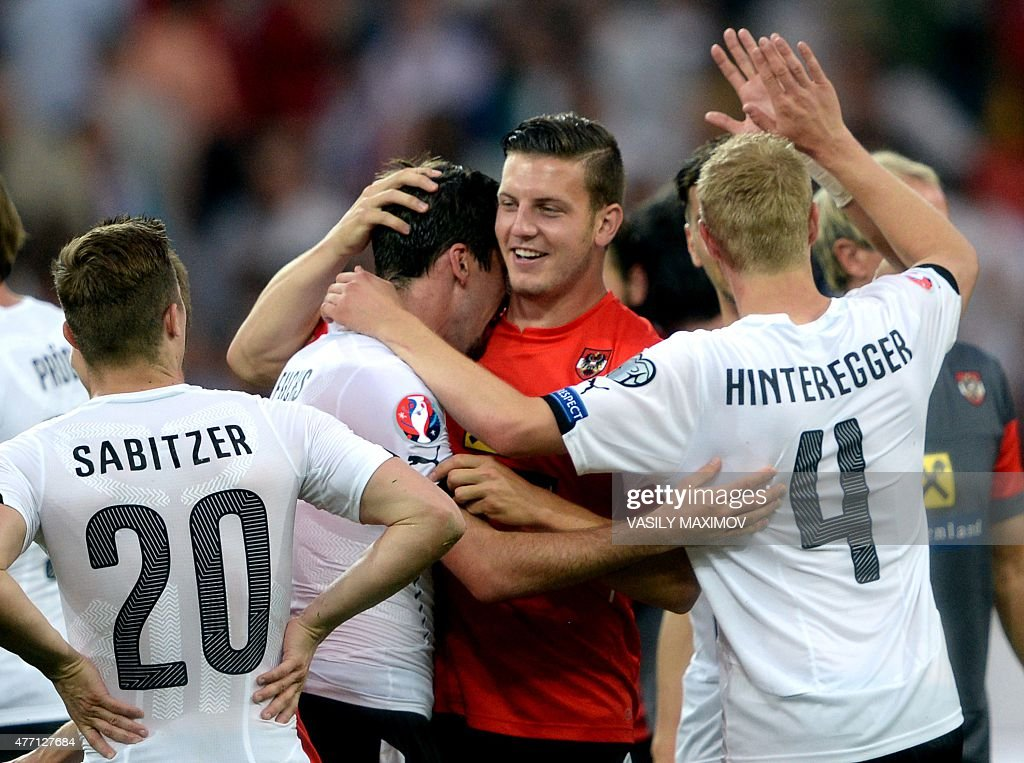Austria's defender Kevin Wimmer celebrates with teammates after winning the UEFA Euro 2016 Group G qualifying football match between Russia and...