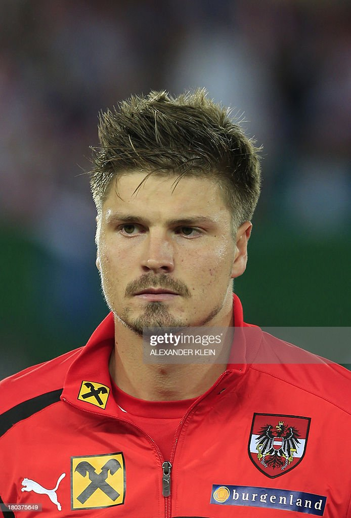 Austria's defender Sebastian Prodl listens to the national anthems ahead of the FIFA 2014 World Cup Group C qualifying football match Austria vs Republic of Ireland, on September 10, 2013, at the Ernst Happel Stadium, in Vienna. Austria won 1-0.
