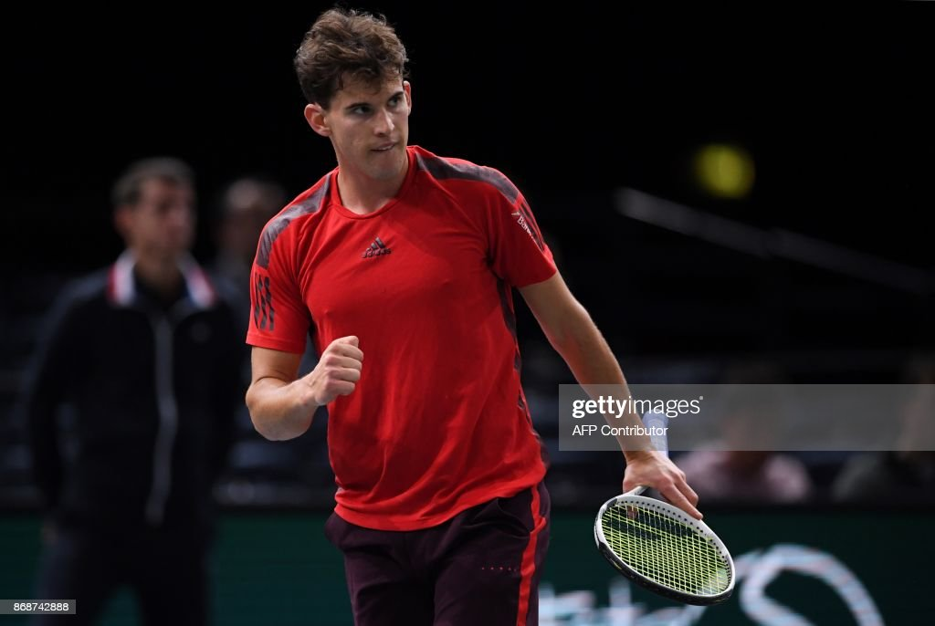 Austria's Dominic Thiem celebrates winning a set against Germany's Peter Gojowczyk during their first round match at the ATP World Tour Masters 1000 indoor tennis tournament on October 31, 2017 in Paris. /