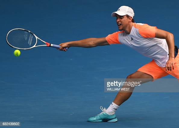 TOPSHOT Austria's Dominic Thiem hits a return against Belgium's David Goffin during their men's singles fourth round match on day eight of the...