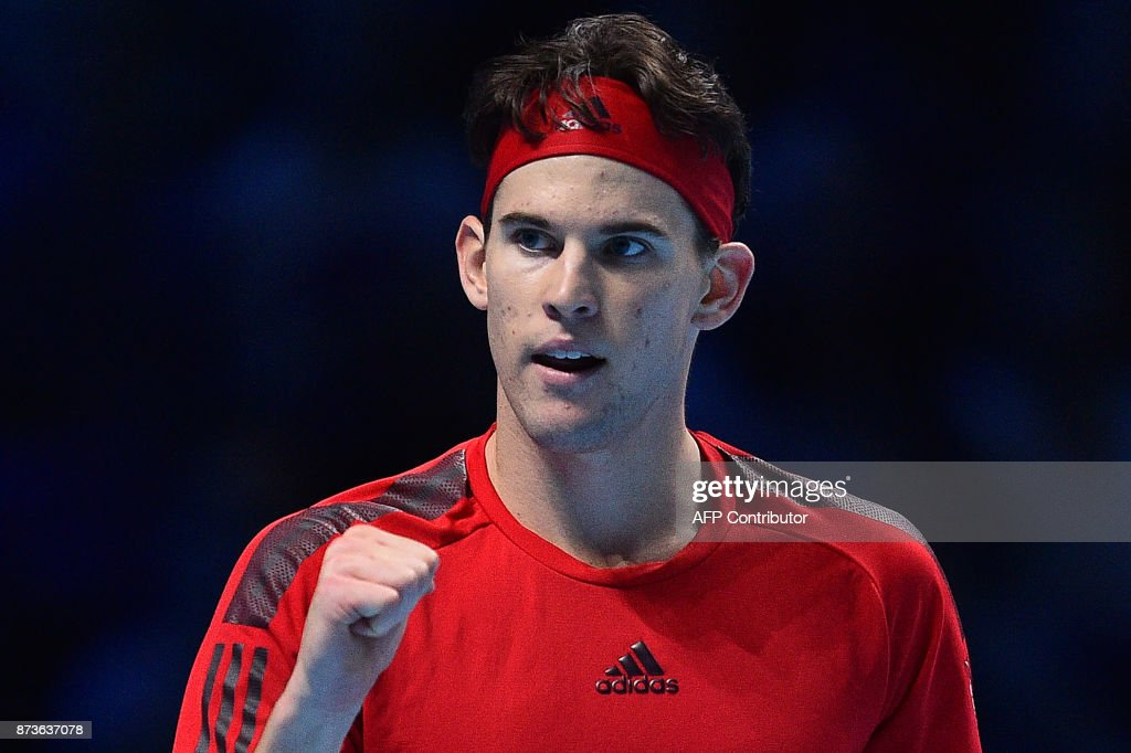 Austria's Dominic Thiem reacts after winning the second set against Bulgaria's Grigor Dimitrov during day two of the ATP World Tour Finals tennis tournament at the O2 Arena in London on November 13, 2017. / AFP PHOTO / Glyn KIRK