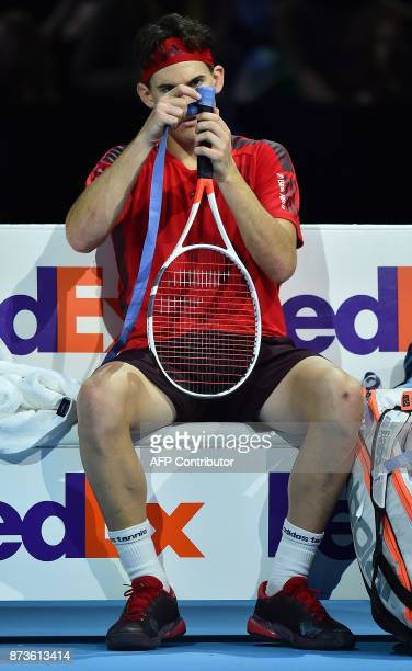 Austria's Dominic Thiem regrips his racket during a break in play against Bulgaria's Grigor Dimitrov during day two of the ATP World Tour Finals...