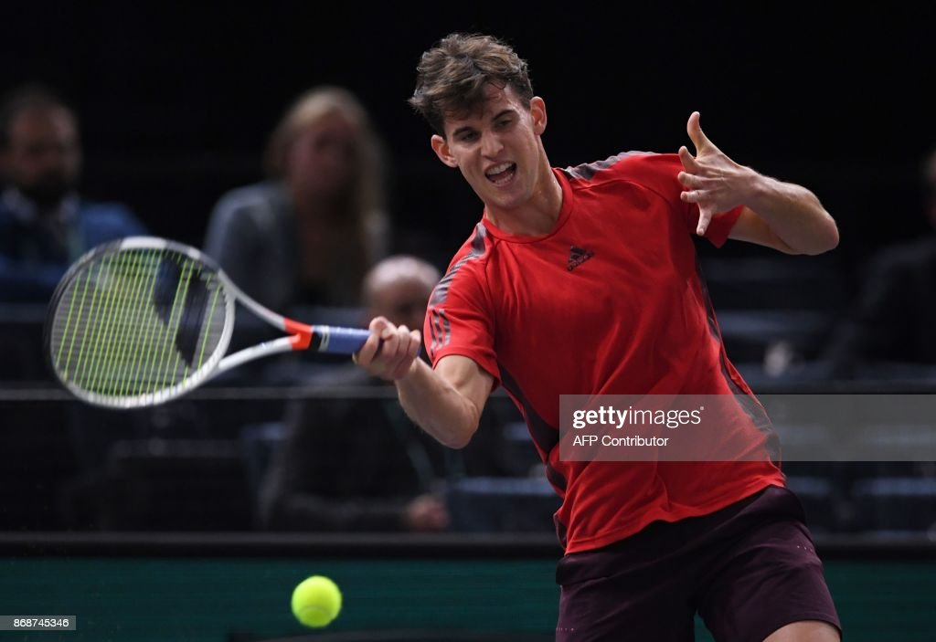 Austria's Dominic Thiem returns the ball to Germany's Peter Gojowczyk during their first round match at the ATP World Tour Masters 1000 indoor tennis tournament on October 31, 2017 in Paris. /