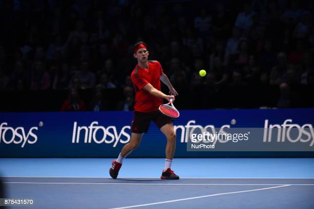 Austria's Dominic Thiem returns to Belgium's David Goffin during a men's singles roundrobin match on day six of the ATP World Tour Finals tennis...