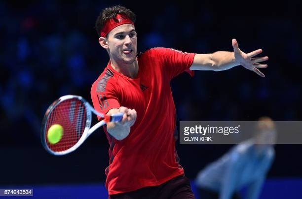Austria's Dominic Thiem returns to Spain's Pablo Carreno Busta during their men's singles roundrobin match on day four of the ATP World Tour Finals...