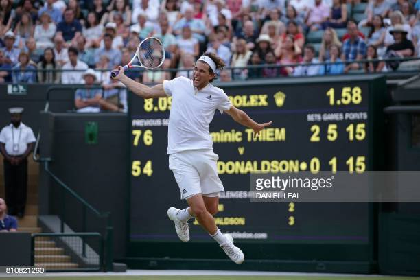 Austria's Dominic Thiem returns to US player Jared Donaldson during their men's singles third round match on the sixth day of the 2017 Wimbledon...