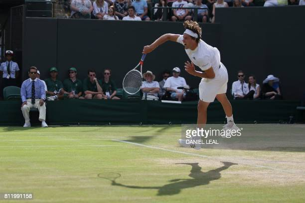 Austria's Dominic Thiem serves against Czech Republic's Tomas Berdych during their men's singles fourth round match on the seventh day of the 2017...
